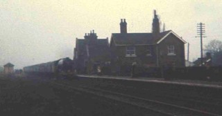 A westbound train pulling into Bottesford Station