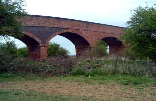The Three Arch Bridge, built in 1860, stood in the fields to the North of the village. It spanned both the River Devon and the railway line which once ran between Newark and Leicester.