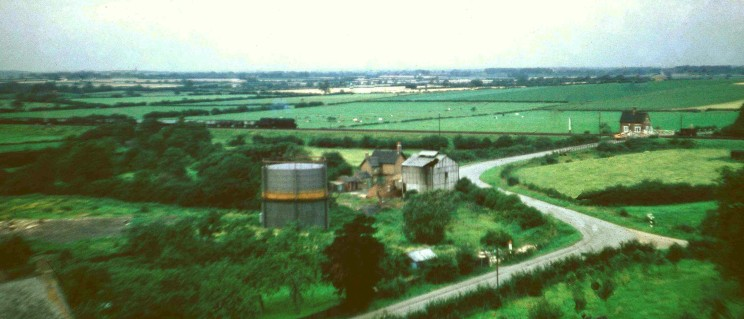 Looking NW from the church tower towards the gas works (gasometer, furnace house and office which is now a day nursery) and the level crossing on Normanton Lane.