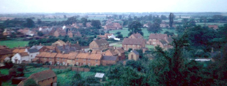 Looking west from the church tower showing Redford's Cottages and The Square.