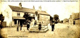 The Cross and Stocks with the butcher's shop and Sutton's shop beyond.