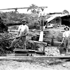 Picture 1 shows the shaft of the pugmill behind the three brickyard workers pausing in their work to pose for the camera.