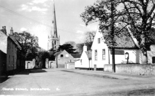 Church St. c. 1960, showing the Rectory gates and to their left the stables, now demolished. Rutland House (No.4 Church St. in 1901, now No. 3) is on the left.