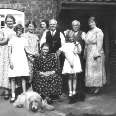 Clarice Bray (L), my great grandparents Francis and Annie (seated), John (Jack) Bray to the right of his brother Francis and Bob the family dog. Photographed at the Bray's house in Muston mid 1920's.