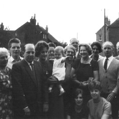 My great aunt Clarice and Kenneth Topps' Silver Wedding Anniversary at Hospital Cottage, Muston, 1964. L to R, Albert Topps, Helen Topps, Cyril Bray, Gerald Coy, Pamela Coy, Elsie Bodger (my grandmother), Iain Coy, unknown, William (Bill) Bray, Clarice Topps, Nelly Bray, Kenneth Topps, Walter Coy and Winnie Coy. Kneeling; Susan and Ann.