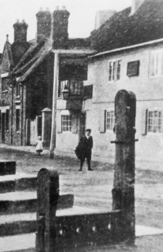 Man and Child outside The Bull  C.1910