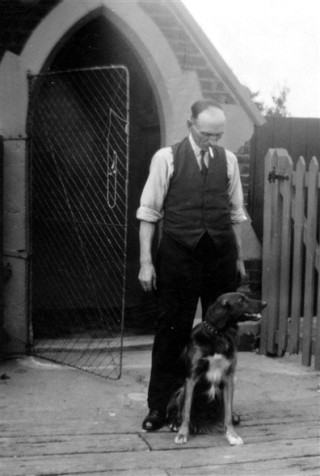 Mr. Sellers, Crossing Keeper, outside the gatehouse, Bottesford c. 1940