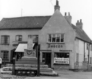 The author recalls that Mr Wood moved to a smaller house, which became a barber's shop. The photograph shows Deacon's hairdressers and tobacconist which occupied these premises for many years from at least 1928 (Kelly's  Directory) until the late 1970's