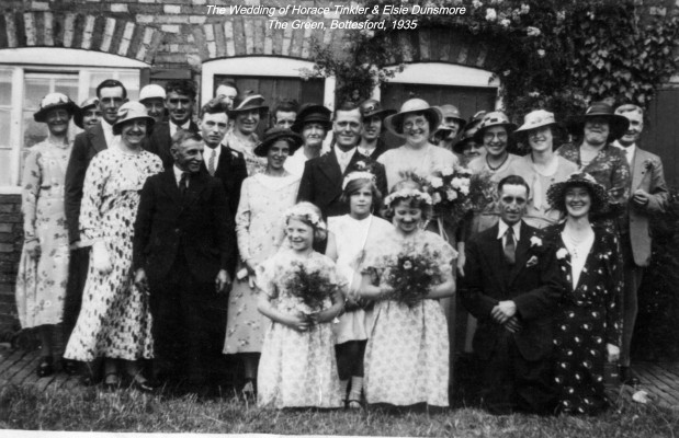 The Wedding of Horace Tinkler and Elsie Dunsmore, The Green, 1935. Kneeling front right: Connie and Arthur Guy. End of 2nd row, left: Mr. Skinner. End of 4th row, left: Thomas Waudby. Just visible at the very back in front of the window: Henry and Frank Dunsmore. Next to the Groom, left: Annie Dunsmore (nee Ricketts). Back row, visible between the Groom and Bride: Louisa Ann Dunsmore (nee Bellamy). Back row, third from right, in white hat: Betty Whatton (nee Waudby)