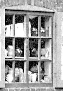 Hardware and crockery in the left window