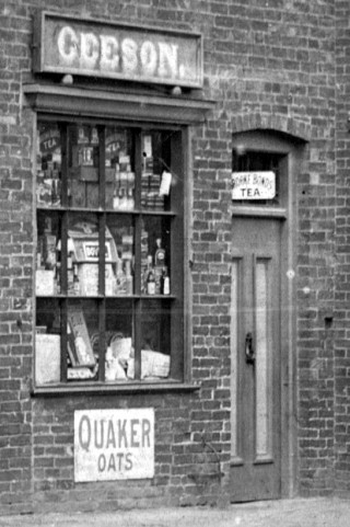 Grocery items displayed in Geesons shop window