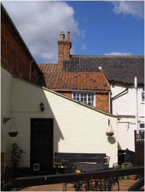Rear of buildings showing no.4 on left and no.6 to the right with blue pantiles.