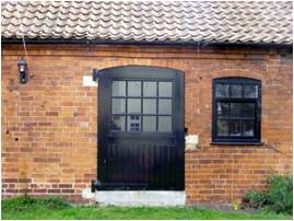 Door and window in stable at rear of no.4.