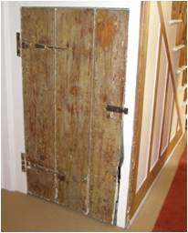 An old door made of three broad planks.
