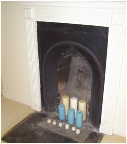 Cast iron fireplace in the rear bedroom.