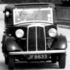 Was this the first car to drive along the new road? Does anybody recognise it.