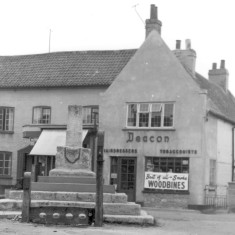 The stocks after they were moved to the east of the cross c. 1960