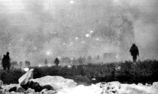 British Soldiers advancing through the gas and smoke at Loos