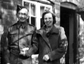 Mum and Dad (Frank & Ingrid Sellers) outside their cottage. 2 Church Street, when Dad was on leave, approx. 1940/41.