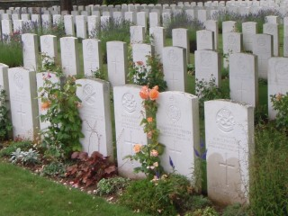 The grave of Capt. H Walter S Hatton at the Douchy les Ayette British Cemetery,