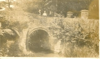 Henry, Mary and Annie Harby on church bridge viewed from the garden of their cottage