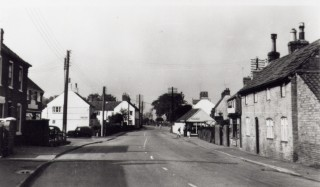 High Street c. 1950  looking to the west end The single story white building on the right is the gas showroom on the corner of Albert (Back) Street mentioned above.