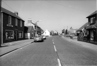 High Street towards Barkestone Lane - left hand side: Andrew's-Weatherfoil; Eric George - Butcher; Old Post Office; Bullock and Driffill. Right hand side: Norris Funeral Directors Chapel of Rest; VG shop
