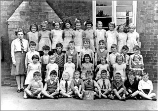 Bottesford Infants Class 1940 - Teacher: Miss Morris (Mrs Edinburgh)  Back row (left to right): not identified, Sheila Coy, Pat Robinson, Ann Lovett, Paddy Jameson, Vera Skinner, Jean Bend, Daphne Marsden, Eileen Fenton, Kathleen Doubleday  Third row (left to right): Francis Stubley, Herbert Turner, John Skinner, Richard Pacey, Keith Samuel, Brian Branston, Jeff Boland, George Pearson, Ian Norris  Second row (left to right): Pat Taylor, Beryl Lamb, Dot Bend, Margaret Deacon, Sheila Mumby, Gina Topps, Gillian Isaac  Front row (left to right): Maurice Fisher, Gerald Pacey, Peter Holmes, Richard Higdon, Peter Stanley, Gel Dolby, Peter Abbott, not identified, Peter Olley