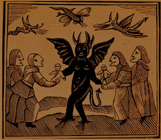Witches receiving images from a Devil, for use in their charms.