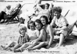 The Dunsmore Family at Skegness, c.1956, sitting on the beach on a sunny day at Skegness, Lincolnshire | Sue Dunsmore