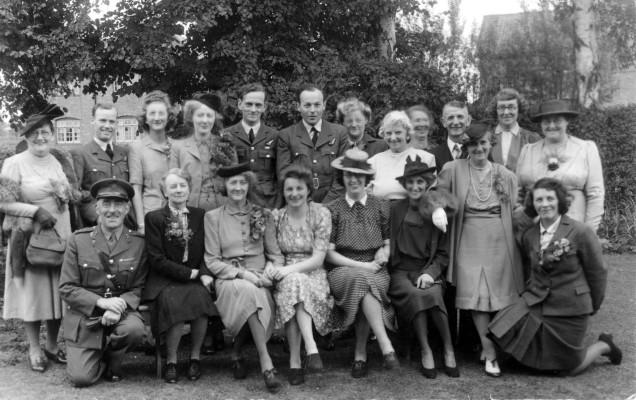 World War 2. Front left: 'Boss' Cox, Headmaster, Bottesford School;  Fourth from left: Winifred Goodson.
