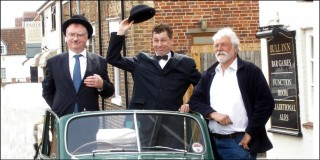 Dave McCormack (left) and Robin Stapleford making a defiant stand in Vic Martin's vintage Morris Minor, outside the Bull, during the 'living history' drama in 2008.