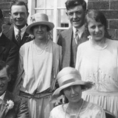 Lizzie Coy and Cecil Hallam seated at their wedding, 1927. Harold Long holding John (L), Walter Coy and my grandmother Winnie with Susan Coy standing next to her (behind Lizzie Coy)..