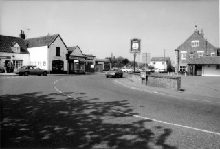 !980s view of the Newsagents; Rainbow Insurance and Nicholls' Garage