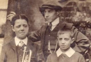 Bob Sutton, as a boy, holding the trumpet.