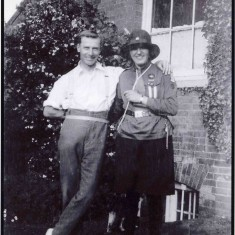 Mary in her Guide uniform with Arthur the gardener at Glebe House, in about 1928/1929. It is known that Arthur also helped in the house but there is no other information about him at present