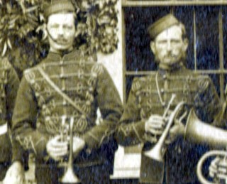 Two buglers from the Volunteer Rifle Corps Band. This photograph dates from the 1880s, possibly from 1882, when the Bottesford Band joined the Belvoir Volunteers. The man on the left may be John Thomas Cooper, who would have been in his late twenties at the time.