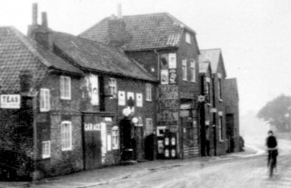 High Street Shops c. 1930. In the 1880s the Post Office was one of these shops.