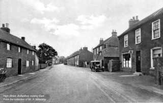 1920/30s view east down High Street towards the Rutland Arms