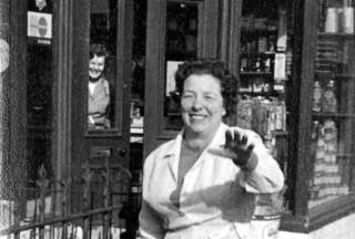 Mrs. Moulsher outside the shop