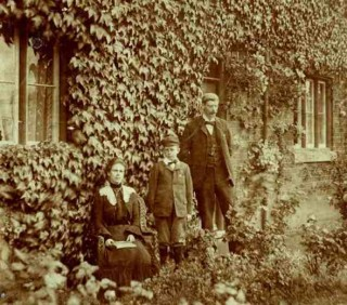 Mr Victor Collett and family in front of the School House