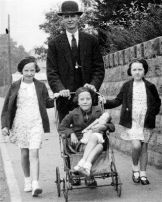 Uncle Edgar Culpin with his two daughters Betty and Barbara (in pushchair) and my cousin Sheila.