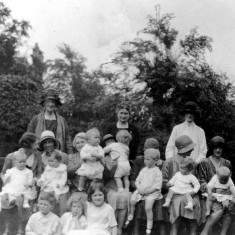 Mrs Lewis with children and nannies in The Park, Nottingham