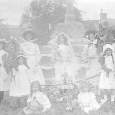 Muston Garland Day at the cross on the village green, c. 1900.