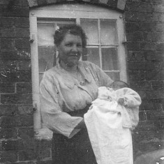 My great grandmother Annie Bray holding Gerald Coy, 1931.