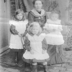 My great grandmother Annie with children Winnie (L), Barbara (C) and Susan (R). Photographed at the back door of the Bray's house in Muston, c. 1905.