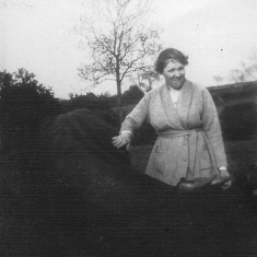 My great grandmother Annie with one of the farm animals in the field behind the Bray's house in Muston.