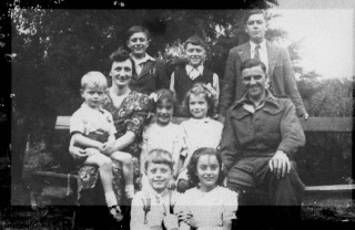 The Norris Family in the 1940s. Back row: Bernard, Ian and Gerald. Middle row: Geoff, Mrs Norris, Carole, Yolande, Mr Norris. Front Row: George and Jennifer