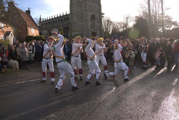 The sun shone, the spectators watched the morris men.