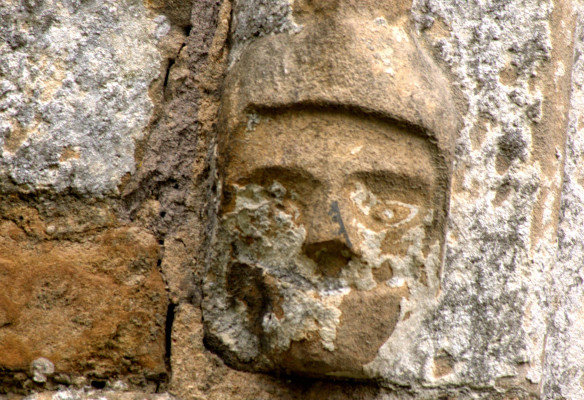 Eroded carving of man's head